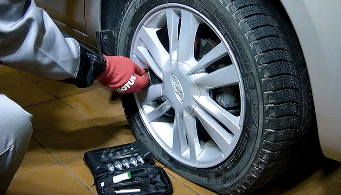 What is the danger of driving on a flat tire?